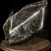 Grosso pezzo di pietra nera.png